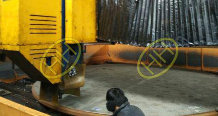 Engineer checking CNC program for drilling tube sheet