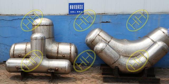 Stainless steel pipe fittings after burst proof testing